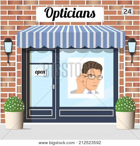 Opticians shop building with red bricks facade. window Poster of a young man in glasses. EPS 10 vector.