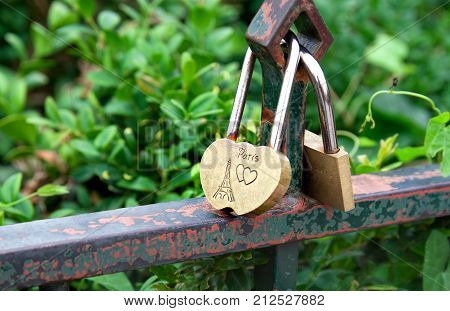 Padlock and heart as symbol of love with text about love in Paris