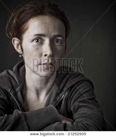 Mature woman with crossed arms