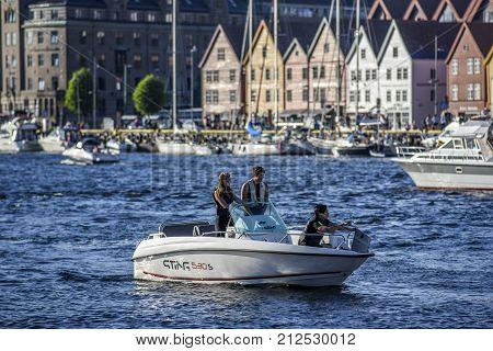 Bergen Norway 23 July 2017: People on a motorboat entering Bergen Norway.