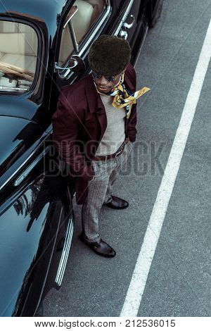 Fashionable African American Man Posing With Car