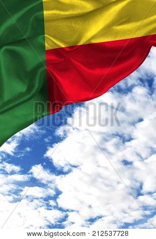 Grunge colorful flag Benin, with copyspace for your text or images against a blue sky with clouds