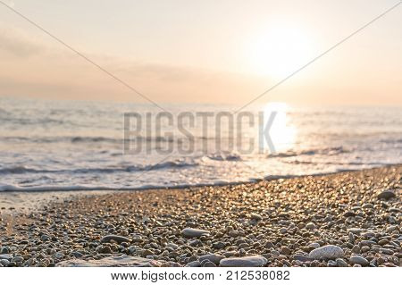 Horizontal shot of the sunset on sea in Sunny summer evening the sun in the frame shining and reflecting in the water
