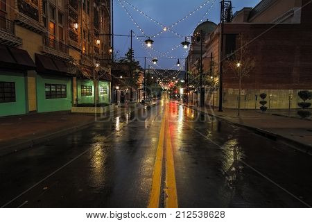 A rainy morning in Kansas City on the streets of the Kansas City Power & Light District which is popular among tourist and shoppers.