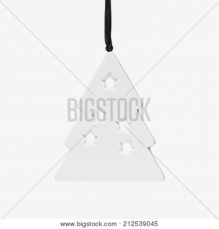 Cutout white decorative Christmas tree closeup isolated on white background Christmas background