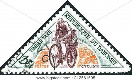 DAHOMEY - CIRCA 1967: A stamp (Postage Due) printed in Dahomey shows postman on a bicycle circa 1967