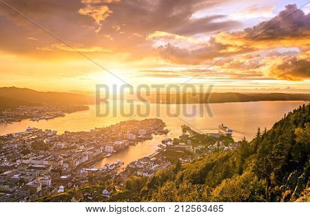 Dramatic panoramic sunset view of the City of Bergen from Floyen mountain. Norway.