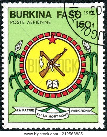 BURKINA FASO - CIRCA 1985: A stamp printed in Burkina Faso shows the Coat of Arms circa 1985