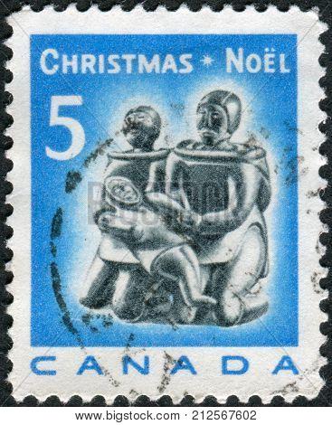 CANADA - CIRCA 1968: Postage stamp printed in Canada Christmas Issue shows Eskimo soapstone carving: Eskimo Family circa 1968