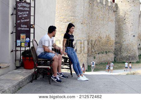 Carcassonne, Languedoc-roussillon, France - August 24 2017: Young Couple Taking A Cigarette Break Ou