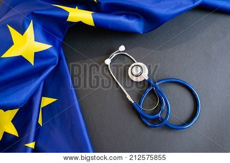 Cost of health care concept, stethoscope and calculator on document and eu flag