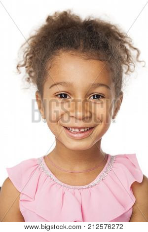 Smiling five Years Old Adorable African American Girl Head and Shoulders Portrait on White Background