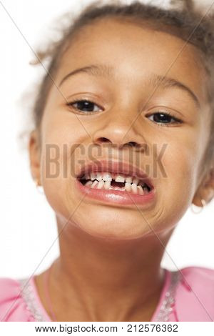 Close up portrait of little african girl isolated on white background