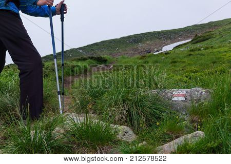 silhouette of a man with tourist sticks in a mountains
