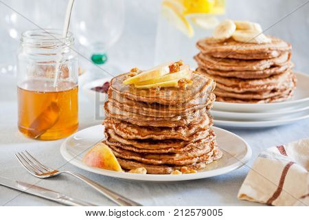 Stacks Of Homemade Whole Wheat Pancakes With Apple Slices