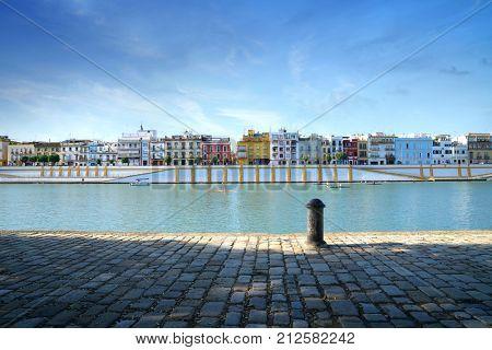 View of Sevilla Triana quarter from Guadalquivir riverbank                poster