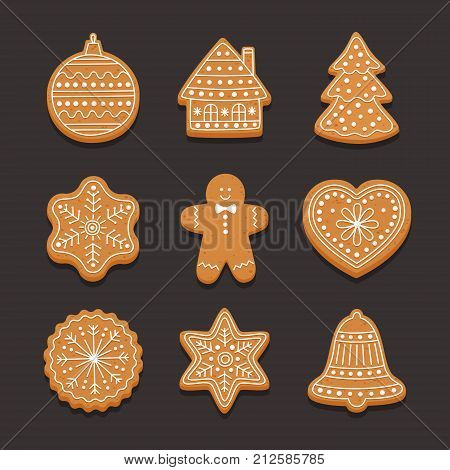 Set Christmas gingerbread: gingerbread house, snowflake, heart, xmas tree and bell on dark background.. Vector illustration.