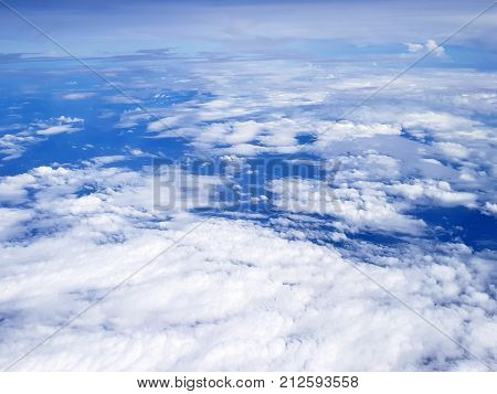 Flying Over Clouds In Plane.