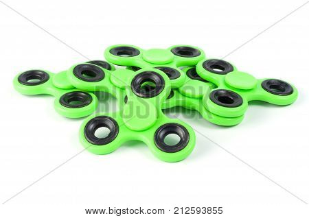 Green fidget spinners - stress relieving toys on a white background