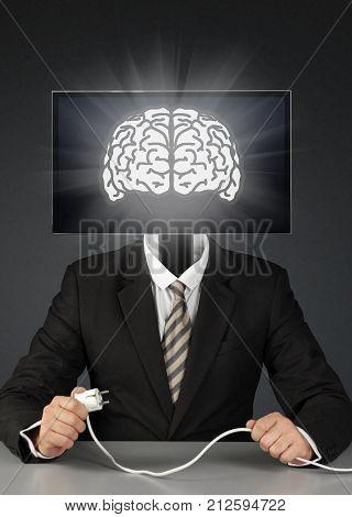 businessman with tv head mass media addiction concept