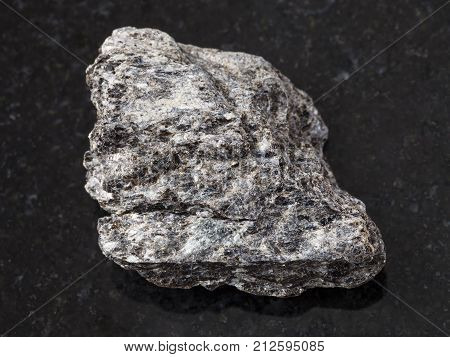 Rough Quartz-biotite Schist Stone On Dark