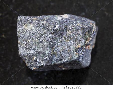 Raw Molybdenite Stone On Dark Background