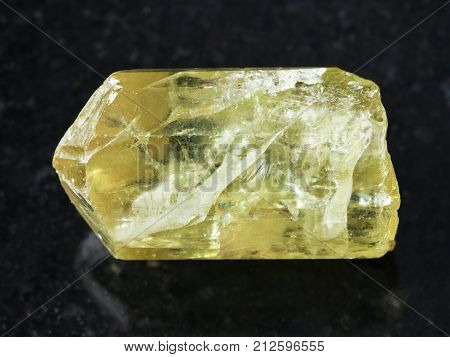 Rough Crystal Of Yellow Apatite Gemstone On Dark