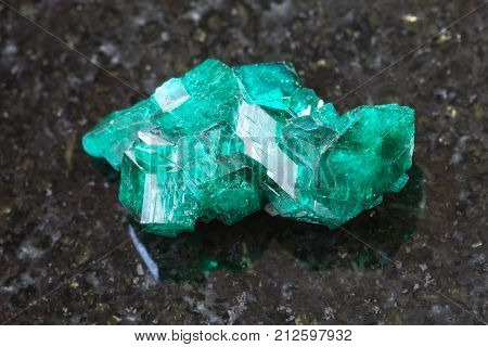 Rough Dioptase Crystal Of Gemstone On Dark
