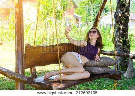 Happy Woman Holding A Smartphone, Outdoor.