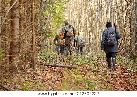 group of hunters during hunting in forest chase hunting