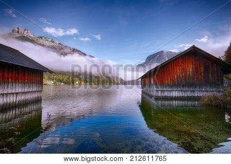 Misty morning on the lake Altausseer See. Foggy autumn scene in the morning. Location: resort Altausseer see Liezen District of Styria Austria Alps. Europe.