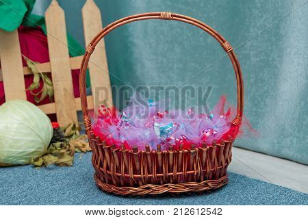 Baskets From The Shoulders. Candy In The Basket. Beautiful Easter Basket
