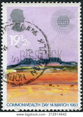 UNITED KINGDOM - CIRCA 1983: Postage stamp printed in England dedicated to Commonwealth Day shows Landscapes by Donald Hamilton Fraser Desert circa 1983