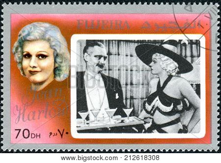 FUJEIRA - CIRCA 1972: A stamp printed in Fujeira shows an American film actress and sex symbol of the 1930s Jean Harlow circa 1972