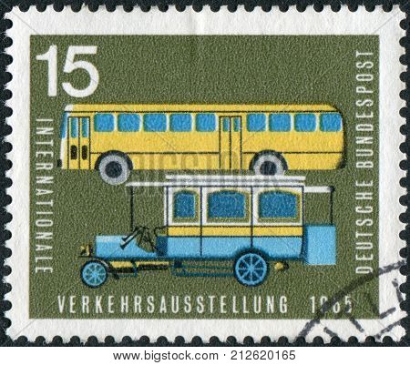 GERMANY - CIRCA 1965: Postage stamp printed in Germany dedicated to the International Transport and Communications Exhibition Munich shows the old and new post buses circa 1965