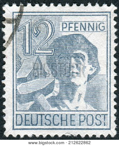 GERMANY - CIRCA 1947: Postage stamp printed in Germany shows the laborer circa 1947