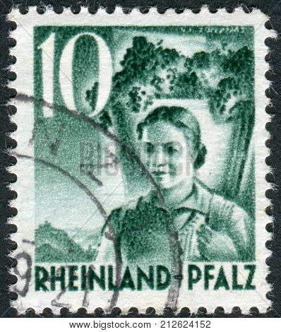 GERMANY - CIRCA 1948: Postage stamp printed in Germany (Rhineland-Palatinate French occupation zone) shows Girl Carrying Grapes circa 1948