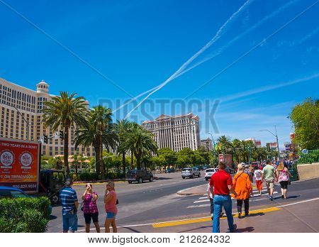 Las Vegas, United States of America - May 05, 2016: The people going near Caesars Palace - a luxury hotel and casino at Las Vegas, United States of America on May 05, 2016