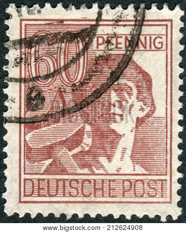 GERMANY - CIRCA 1948: Postage stamp printed in Germany shows the laborer circa 1948