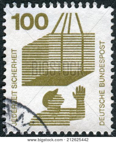GERMANY - CIRCA 1972: Postage stamp printed in Germany Prevent accidents Issue shows Hoisted cargo circa 1972