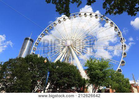 Atlanta GA USA - August 18 2017: SkyView Atlanta Ferris wheel - 20-story Ferris wheel in Centennial Park providing scenic views from climate-controlled gondolas