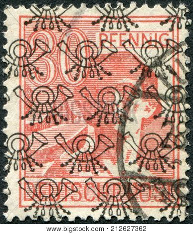 GERMANY - CIRCA 1947: Postage stamp printed in Germany (overpint Type B: US and British occupation zone) shows the laborer circa 1947
