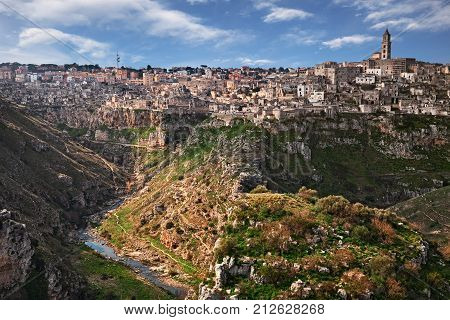 Matera, Basilicata, Italy: landscape of the picturesque old town (sassi di Matera) with the houses carved into the tufa rock over the deep ravine
