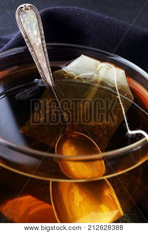 Cup of hot tea with teabag. Cup is from clear glass
