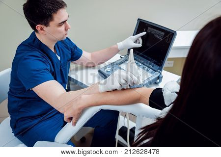 Patient with orthopedist doctor in his office. Elbow sonography.