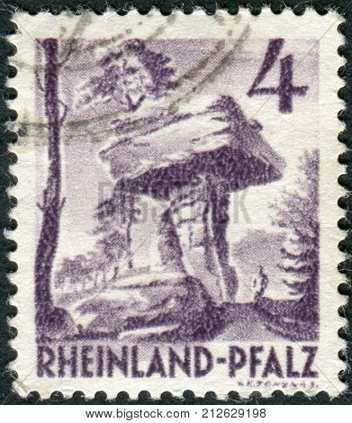GERMANY - CIRCA 1949: Postage stamp printed in Germany (Rhineland-Palatinate French occupation zone) shows the Devil's Table (Hinterweidenthal) circa 1949