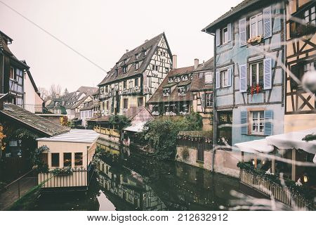 COLMAR FRANCE - NOV 23 2014: French city of Colmar ready for Christmas with decorations at the windows near the main water canal of the city called Little Venice