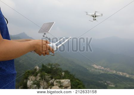 closeup of drone flying over the chinese great wall