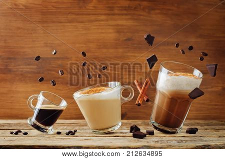 Different types of coffee with flying ingredients. Espresso cappuccino and mocha coffee