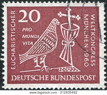 GERMANY - CIRCA 1960: A stamp printed in Germany dedicated to 37th Eucharistic World Congress Munich depicted Dove Chalice and Crucifix circa 1960
